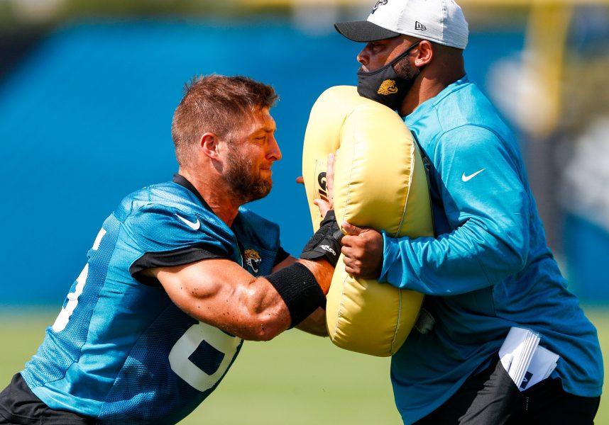 Jun 14, 2021; Jacksonville, Florida, USA;  Jacksonville Jaguars tight end Tim Tebow (85) participates in blocking drills during minicamp at Dream Finders Homes practice complex Mandatory Credit: Nathan Ray Seebeck-USA TODAY Sports